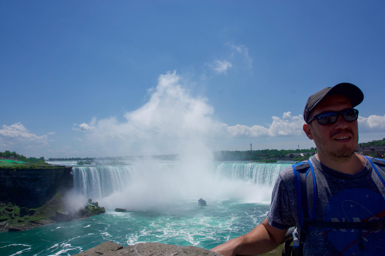Manu posing with the falls