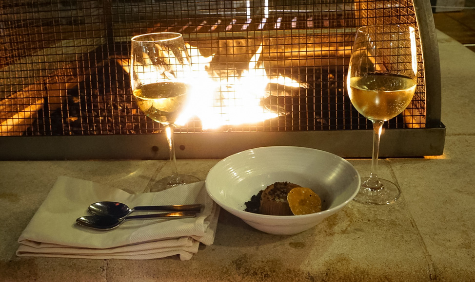 Yummy nightcap by the fireplace on the water